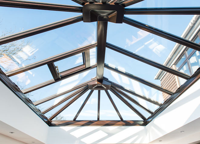 Conservatory roof interior with blue sky