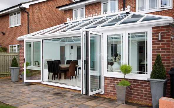 Conservatory with bi-folding patio doors