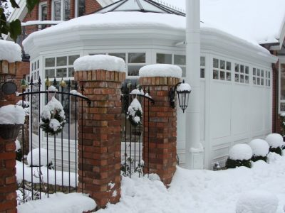 Snow covered conservatory in winter